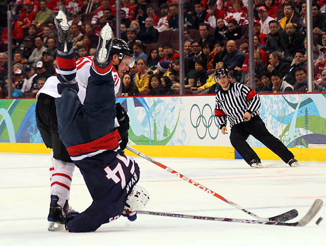 Bobby Ryan of the U.S. (54) took a nasty spill after being hit by Mathias Seger in their Wednesday matchup.