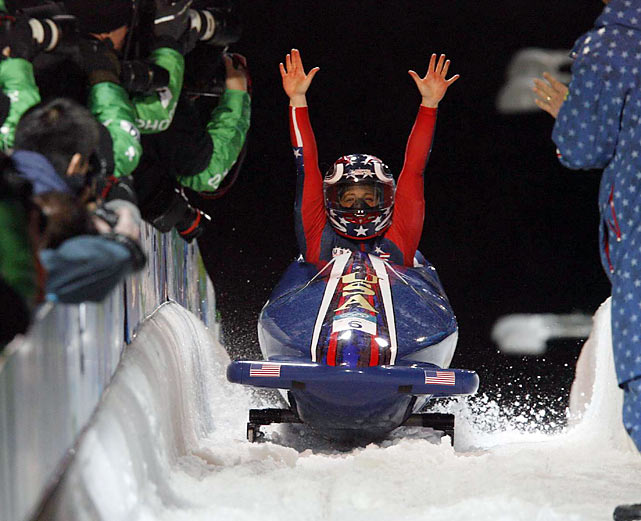 Erin Pac and Elana Meyers celebrate their run in the women's bobsled, which was good enough to earn them a bronze medal.