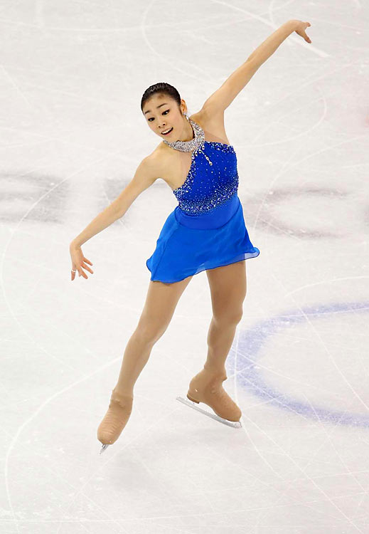 With one of the best performances of all time, Kim Yu-na of South Korean won the gold in women's figure skating with an astounding 228.56 points, shattering her previous world record by more than 18 points. It was South Korea's first medal at the Winter Olympics in a sport other than speedskating.