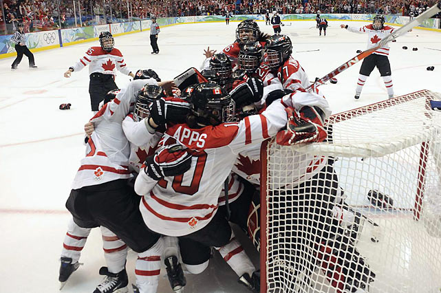 Marie-Philip Poulin scored two goals and Shannon Szabados made 28 saves to make Canada's victory celebration possible.