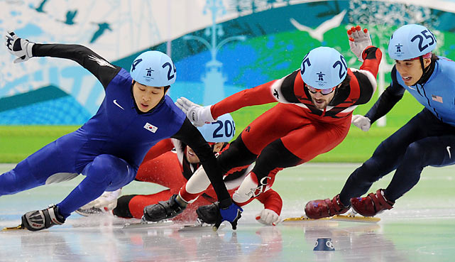 In the 500, a short race often filled with spills, Canada's Francois Louis-Tremblay (208) and South Korea's Sung Si-bak (24) both fell on a dash to the finish, seemingly giving Canada's Charles Hamelin the gold and Apolo Ohno the silver. But Ohno was later disqualified on a controversial ruling that he pushed Tremblay.