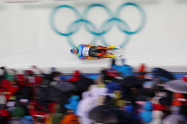 Two heats were completed successfully on the luge track Saturday on a track made shorter, slower and safer in the wake of Nodar Kumaritashvili's death during a training run the day before.