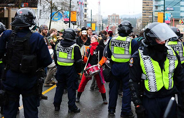 For the second consecutive day, police were called on to handle anti-Olympic protests. Seven people were arrested. There were no immediate reports of injuries.