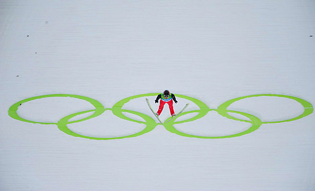 With the Olympic rings as a backdrop, Simon Ammann finishes one of his jumps.