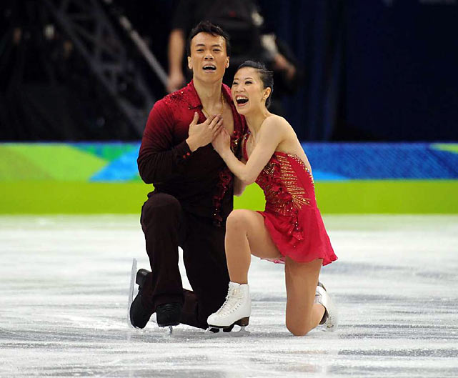 When Shen Xue, 31, and Zhao Hongbo, 36, finished their routine, Zhao knelt to the ice, burying his face in his hands while his wife patted his back. He pumped his fist several times while she beamed, her grin wide and bright. This is their fourth Olympics.