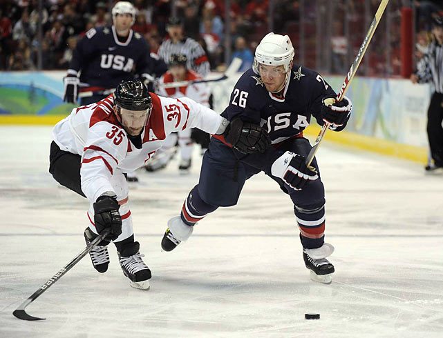 The U.S. men's hockey team avoided a repeat of its opening-game letdown in Turin by defeating Switzerland 3-1 on Tuesday. During the 2006 Games, the Americans began with a 3-3 tie against Latvia and never challenged for a medal.