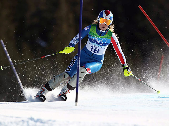 Seeking her second gold medal in as many days, Lindsey Vonn led the super-combined after the downhill portion, then tumbled in her slalom run. She still has three more events