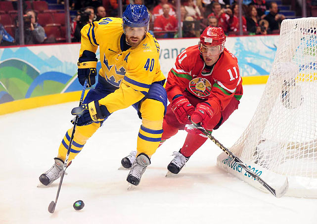 Henrik Zetterberg (8) and his teammates jumped to a 3-0 lead over Belarus and held on for a 4-2 victory as backup goalie Jonas Gustavsson made 17 saves.