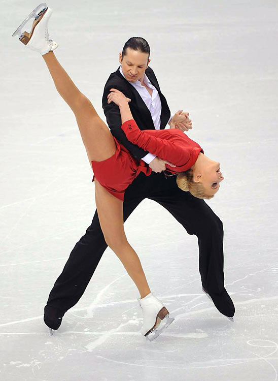 It takes two to tango, and the best at the Olympics were world champions Oksana Domnina and Maxim Shabalin. The couple won the compulsory dance, an exercise -- some say it's monotonous -- to repetitive music that began the ice dancing competition.