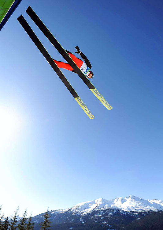 Switzerland's Simon Ammann won the large hill to become the first ski jumper with four individual Olympic titles.