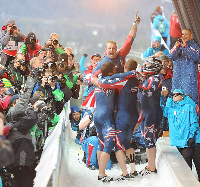 """Paired with push teammates Justin Olsen, Steve Mesler and Curt Tomasevicz, Steve Holcomb drove his """"Night Train"""" to the gold medal in four-man bobsledding, the first American pilot to do so since Francis Tyler at St. Moritz in 1948."""