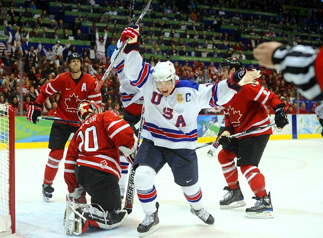 American captain Jamie Langenbrunner celebrates after scoring on a shot deflection off his left skate to give the U.S. a 4-2 lead in the third period.