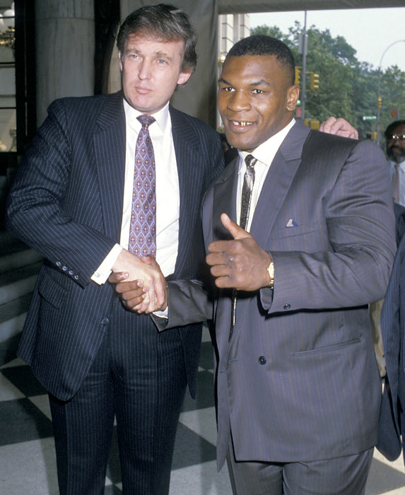 Donald Trump and Mike Tyson pose after the press conference promoting Tyson's fight against Michael Spinks.