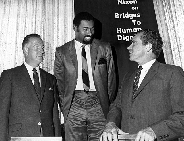 """Chamberlain poses with United States president Richard Nixon with and Maryland governor Spiro T. Agnew during an event in Mission Bay, Calif. Chamberlain was a supporter of Nixon and helped tout the president's ideas on """"black capitalism."""""""