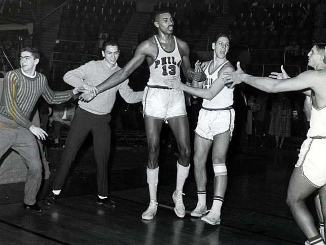 Chamberlain is greeted by Philadelphia Warriors teammates and fans after pouring in a NBA record 100 points in a 169-147 victory over the Knicks.