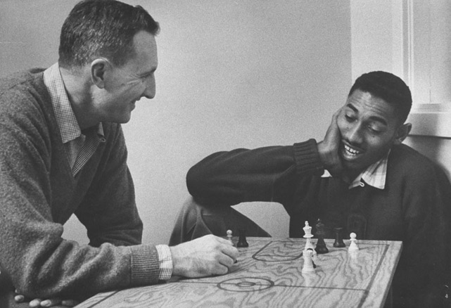 In his two seasons playing for the Jayhawks, Chamberlain, shown playing chess during his college days, scored an impressive 1,433 points and helped Kansas the title game against North Carolina in 1958.