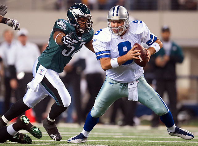 Tony Romo escaped the Philadelphia pass rush long enough to complete 23 of 35 passes for 244 yards and two touchdowns.