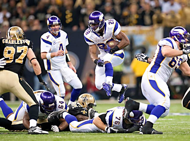 Adrian Peterson and the Vikings finished with 475 yards offense but were undone by five turnovers.