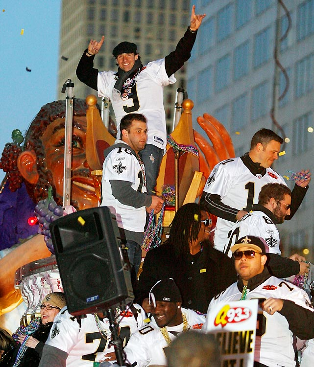 MVP Drew Brees (top) sat on a throne as players threw beads toward the crowds that lined the city streets.