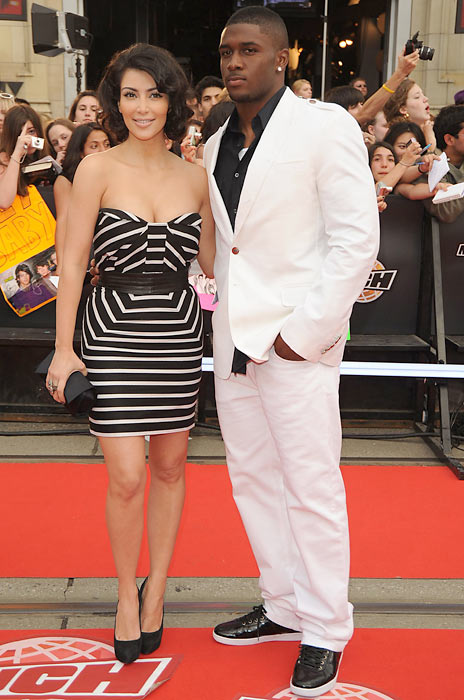 Kim Kardashian and Reggie Bush arrive on the red carpet of the 20th Annual MuchMusic Video Awards in Toronto.