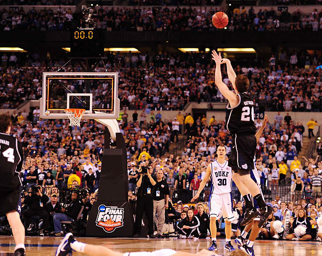 In one of the most compelling national title games in tournament history, Butler star Gordon Hayward just missed a half-court shot for the national title. With Butler trailing 61-59 in the waning seconds, Hayward rebounded an intentionally missed free throw by Duke's Brian Zoubek, dribbled to half court (thanks to a bone-crushing screen from Matt Howard) and released the ball just as the buzzer sounded. The ball majestically soared toward the rim, eventually hitting off the backboard and front rim before bouncing out. Butler just missed a storybook ending, and Duke earned its fourth national title.