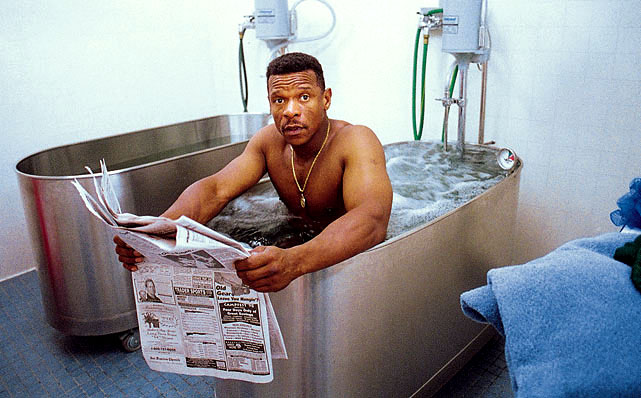Stealing bases pounds the body, so Henderson enjoyed this whirlpool bath after a game against the Tigers in May, 1998.