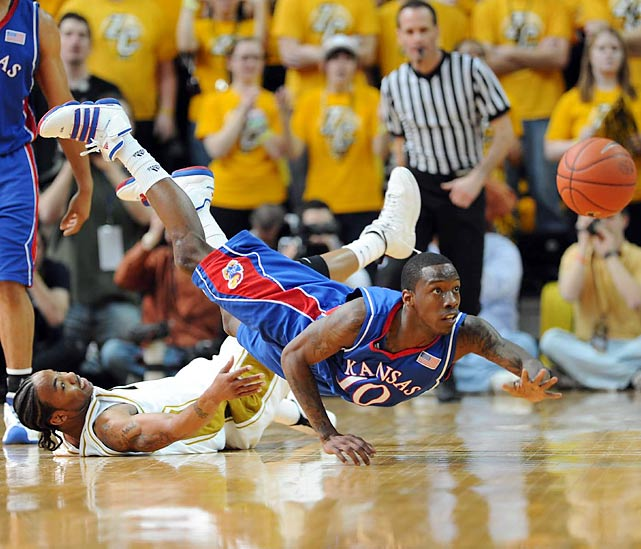 Guard Tyshawn Taylor scrambles for the ball as the Jayhawks defeated rival Missouri 77-56 on March 6.