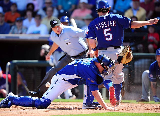 Ian Kinsler scores during an exhibition game against the Kansas City Royals in Arizona.