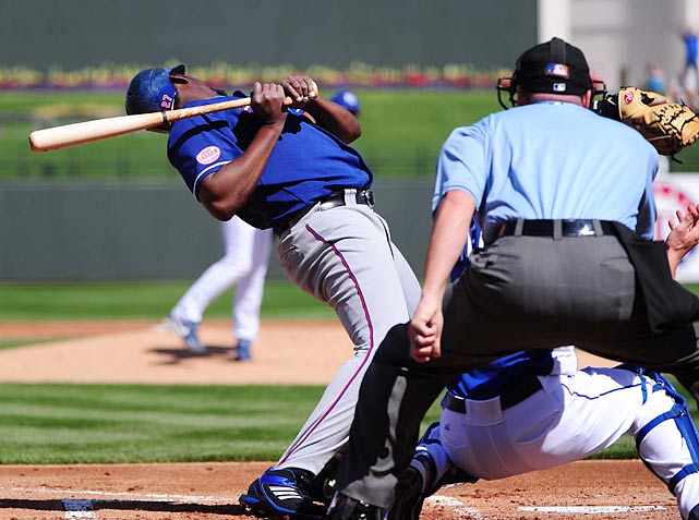 Vladmir Guerrero of the Texas Rangers steers clear of a wayward pitch during a game against the Kansas City Royals.