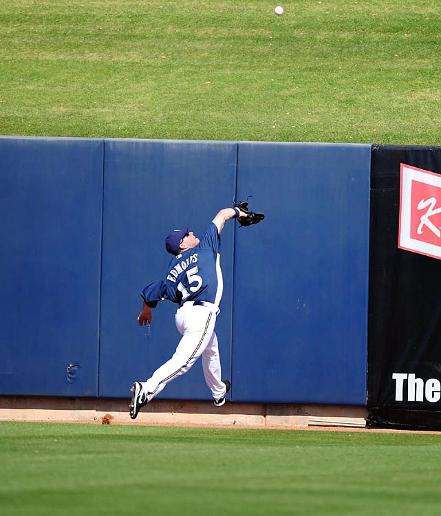 Jim Edmonds leaps for a catch during an exhibition game between the Milwaukee Brewers and the San Francisco Giants in Arizona.