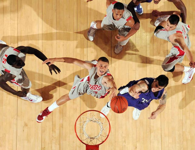 New Mexico's Phillip McDonald battles for a rebound  in a game against TCU.