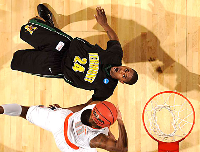 Vermont guard Maurice Joseph looks up as Syracuse  guard Scoop Jardine drives to the basket in the first round of the NCAA tournament on March 19 at the HSBC Arena in Buffalo, NY. Syracuse won 79-56.