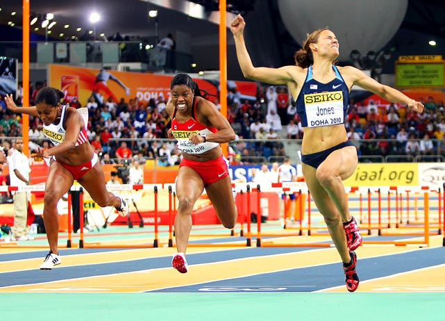 Lolo Jones of United States celebrates winning gold in the  60m hurdles at the IAAF World Indoor Championships on March 13 in Doha, Qatar.
