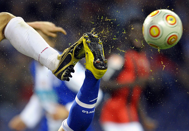 An FC Porto and an Olhanense player try to kick the ball during their Portuguese first league football match on March 6 at Dragao Stadium in Porto, Portugal. The match finished in a 2-2 draw.