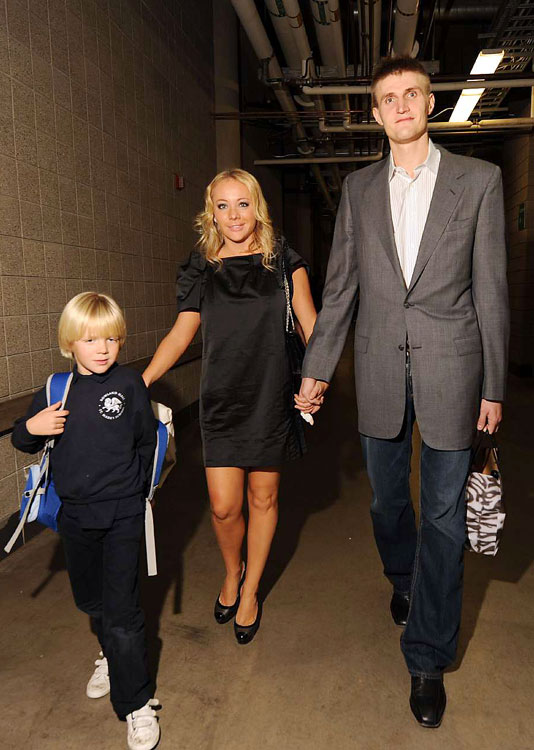 Andrei Kirilenko with his son and wife, Masha, at the EnergySolutions Arena before a Jazz game.