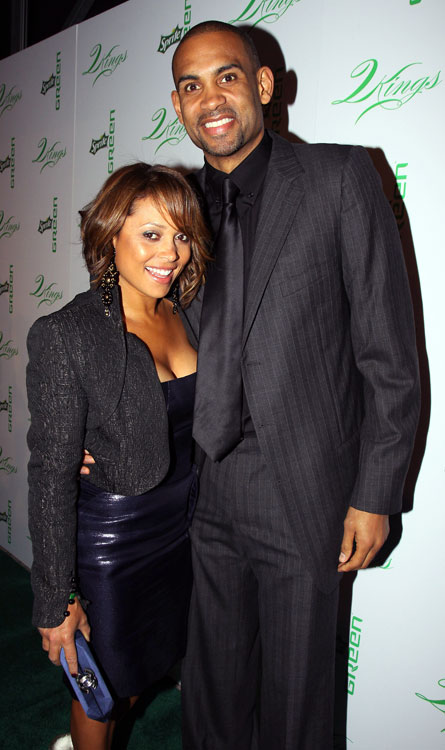 Suns forward Grant Hill and his wife, Tamia, a six-time Grammy-nominated singer and producer, flash a quick smile.