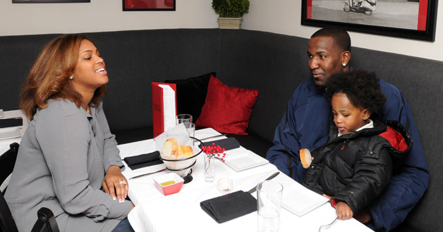 Oklahoma City Thunder center Kendrick Perkins shares a meal with his son and wife, Vanity.
