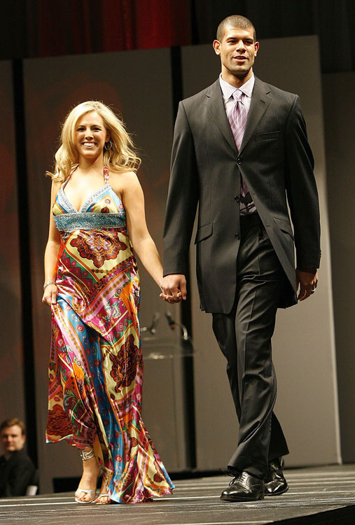 Shane Battier walks the catwalk with his wife during a charity event.