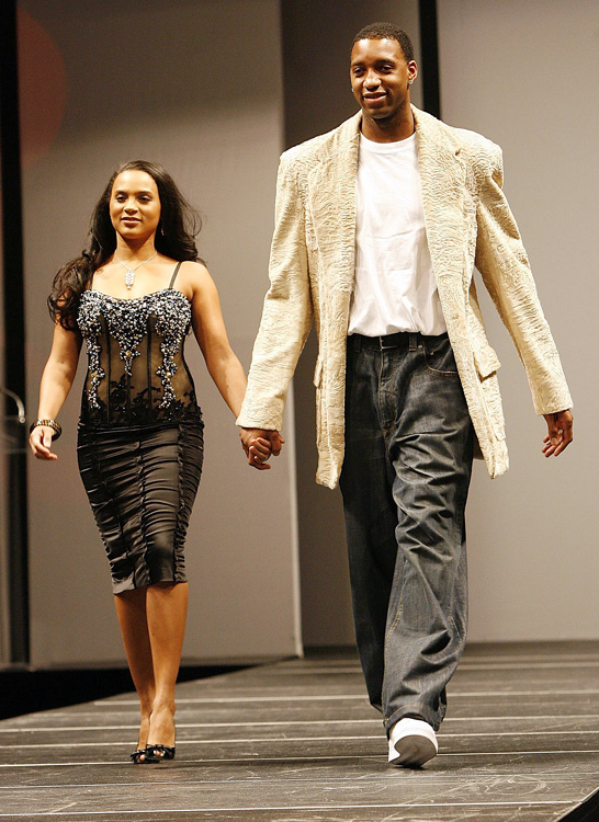 Tracy McGrady and his wife, CleRenda, show their stuff during a charity fashion show.