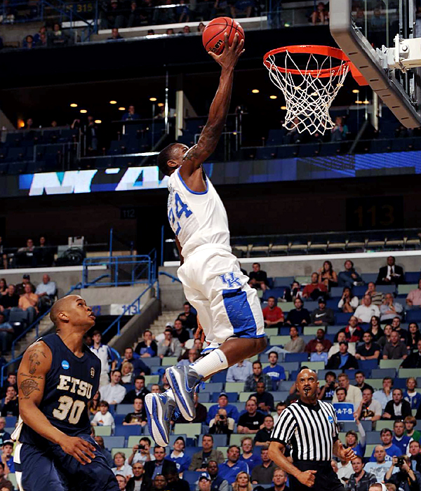 Freshman Eric Bledsoe (No. 24) gets two on the drive, but he was a bigger thorn from the outside, as his eight three-pointers set a Kentucky record for an NCAA tourney game. Connecting on his first eight long-range attempts, Blesdoe finished with 29 points as UK dominated.