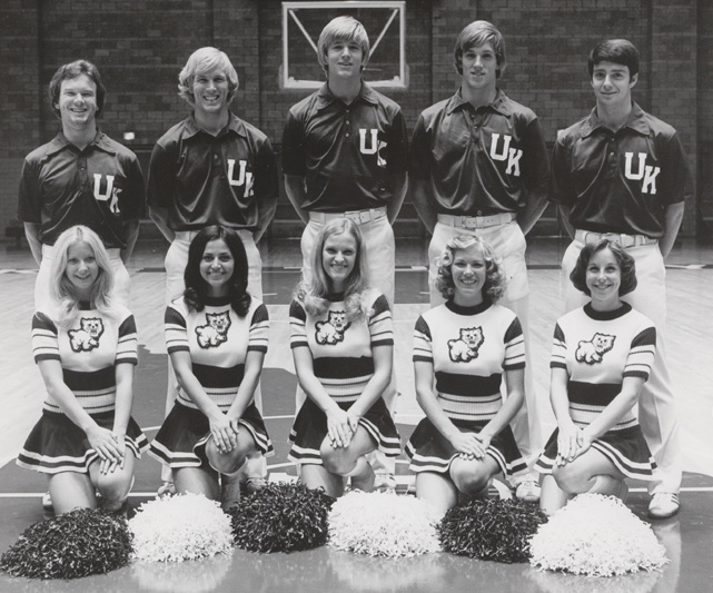 The cheerleading squad and the 1967-68 team pose for a team portrait.