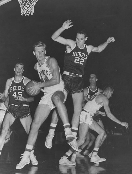 A two-sport star at Kentucky, the 6-foot-5-inch center was a consensus All-America as a senior in 1964 and led the school to SEC titles that season and in '62. Nash, who earned his nickname because of his blond hair, spent time with the Lakers and ABA's Kentucky Colonels and saw limited professional baseball action with the White Sox and Twins.