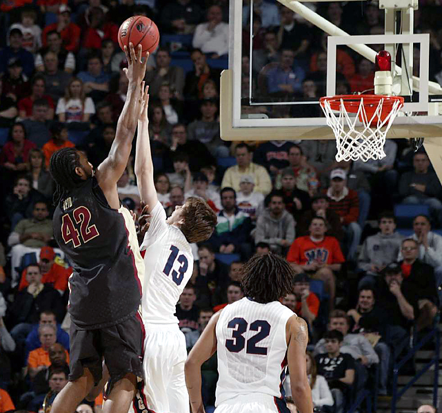 Florida State's Ryan Reid goes high to get his shot off over Gonzaga's Kelly Olynyk. Matt Bouldin scored 14 of his 17 points in the second half to help eighth-seeded Gonzaga, which converted 8-of-10 free throws down the stretch, move on to the second round.