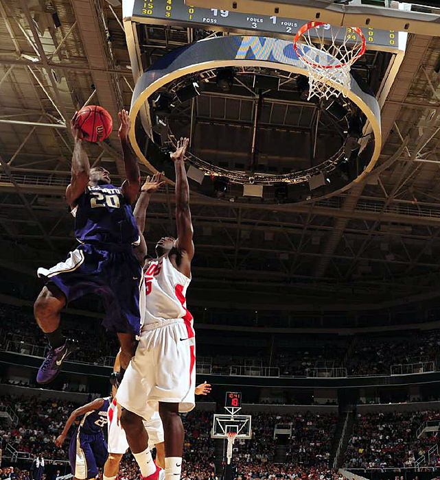 After a rocky regular season, Quincy Pondexter (No.20) and his Washington Huskies are rolling at exactly the right time.  Pondexter scored 18 points and 11th-seeded Washington extended its incredible late-season surge all the way to the NCAA tournament's regional semifinals.
