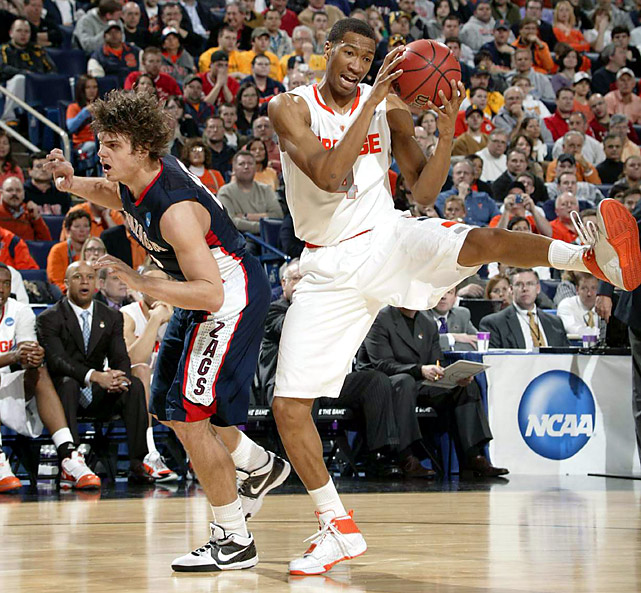 Wes Johnson (4), the Big East player of the year, scored a career-high 31 points and pulled down 14 rebounds as top-seeded Syracuse hit a dozen 3-pointers to stun the Zags.