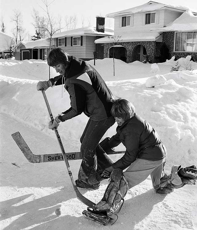 Gretzky lived with a local family while he played in Sault St. Marie, Ontario. Here, the 17-year-old enjoys a neighborhood game of street hockey.