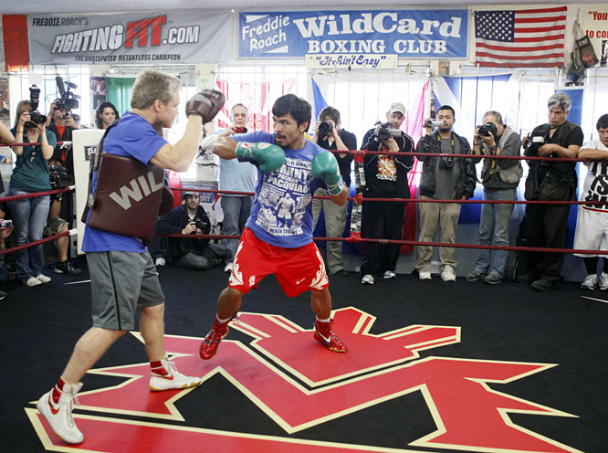 Pacquiao, a dynamic southpaw who was SI.com's Fighter of the Year in 2008 and '09, is a 6-to-1 favorite to retain the title.