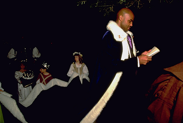 Barkley dresses in royal regalia with children holding his cape at a charity fundraiser in February 1995.