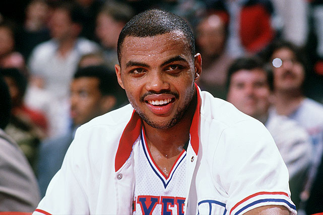 Barkley smiles on the bench during a 76ers game against the Portland Trail Blazers in February 1986. Barkley averaged 20,0 points and 12.8 rebounds that season as the 76ers reached the Eastern Conference semifinals.