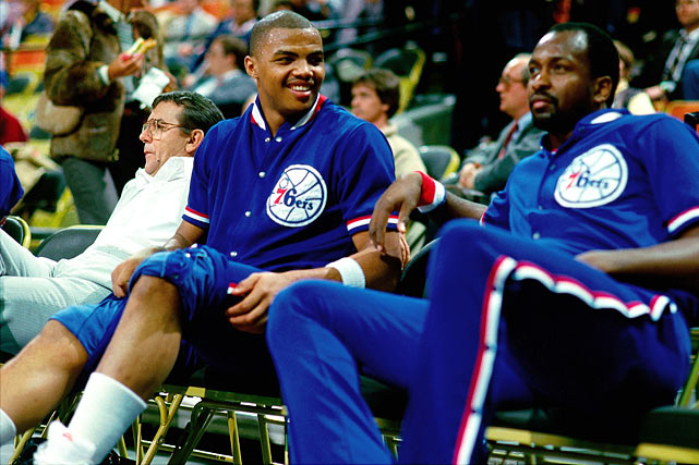 Barkley smiles on the bench next to 76ers teammate Moses Malone at The Spectrum in Philadelphia in 1985. Barkley and Malone overlapped with the 76ers for two seasons, losing in the Eastern Conference Finals in 1985 and the conference semifinals in 1986.